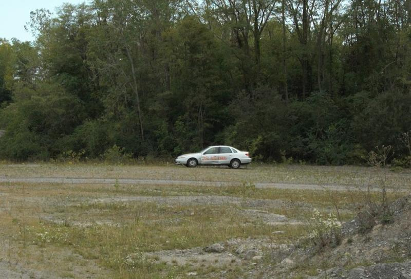 A car, viewed from a safe distance, awaits destruction during an ATF post-bombing training course in Niagara County. Students will attempt to piece together clues in a mock investigation.