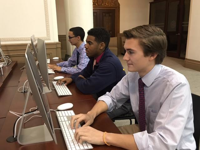 Canisius High School students work on computers in newly renovated library