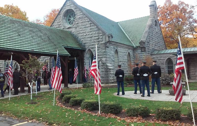 Military and members of the Patriot Guard Riders stand at attention outside the chapel on the grounds of Forest Lawn Cemetery prior to the interment service for Roy Fink.