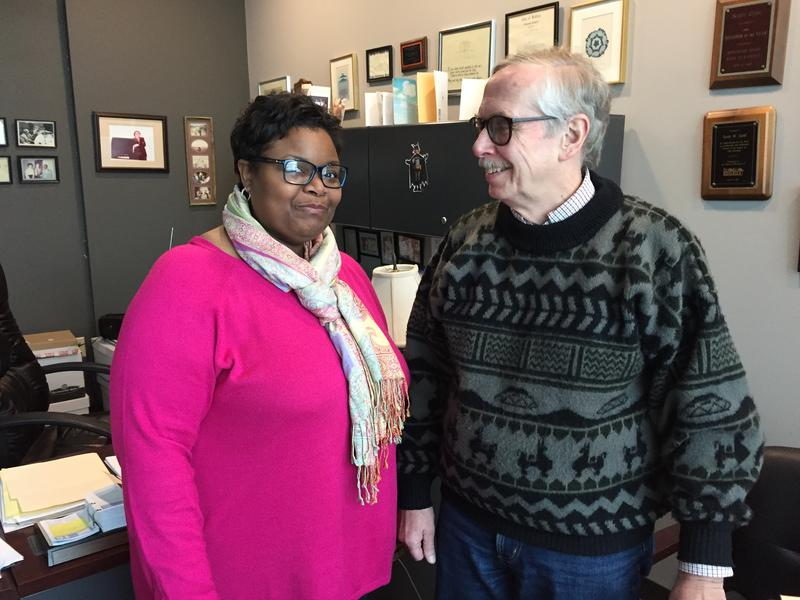 DeAnna Eason (left) stands next to Scott Gehl in the office of HOME's Executive Director.