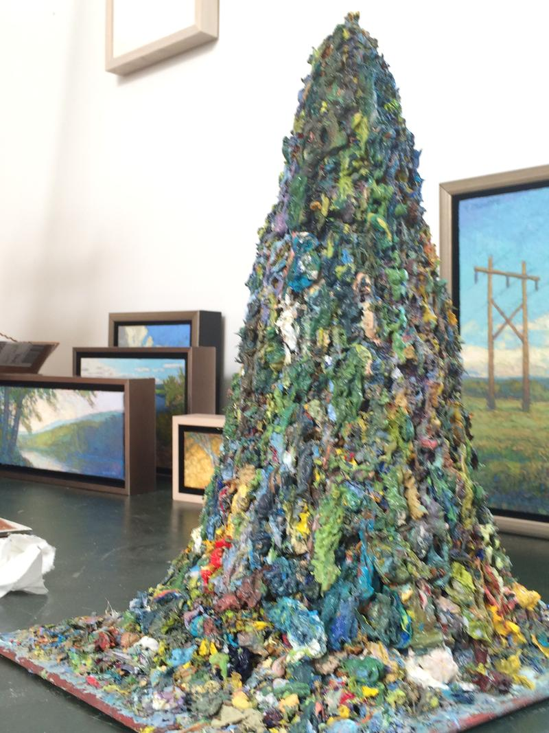 What looks like a desktop volcano is actually a pile of scrapings, removed from canvases as Paquette works through the fine detail of his paintings.