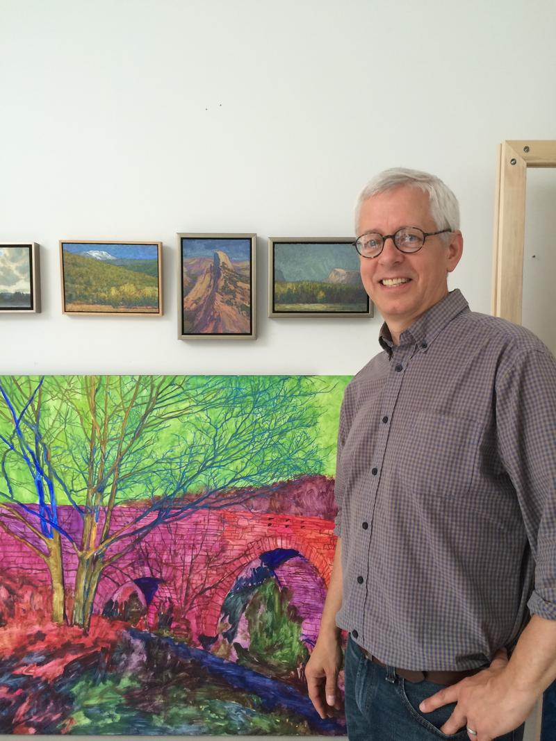 Artist Thomas Paquette stands in front of some of his works, some of which are finished, others still evolving.