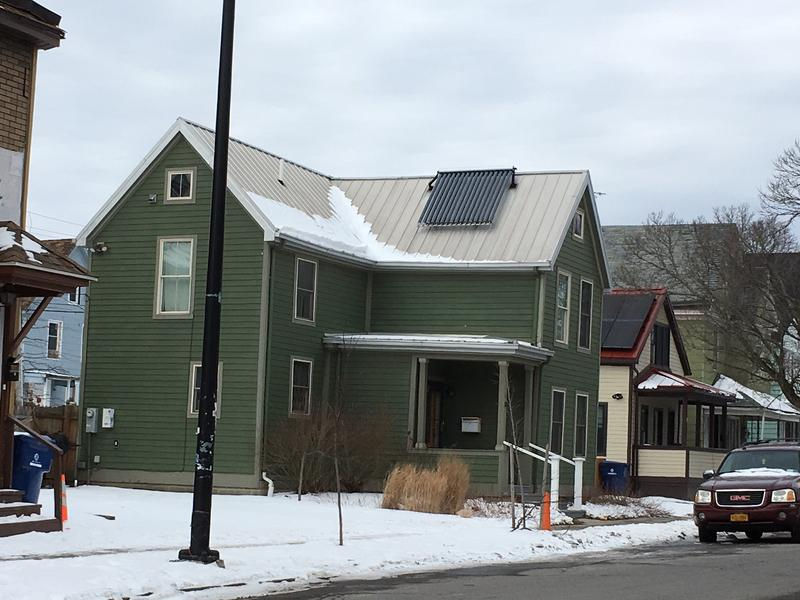 PUSH's renovations included installing a solar panel on this home to reduce utility costs.