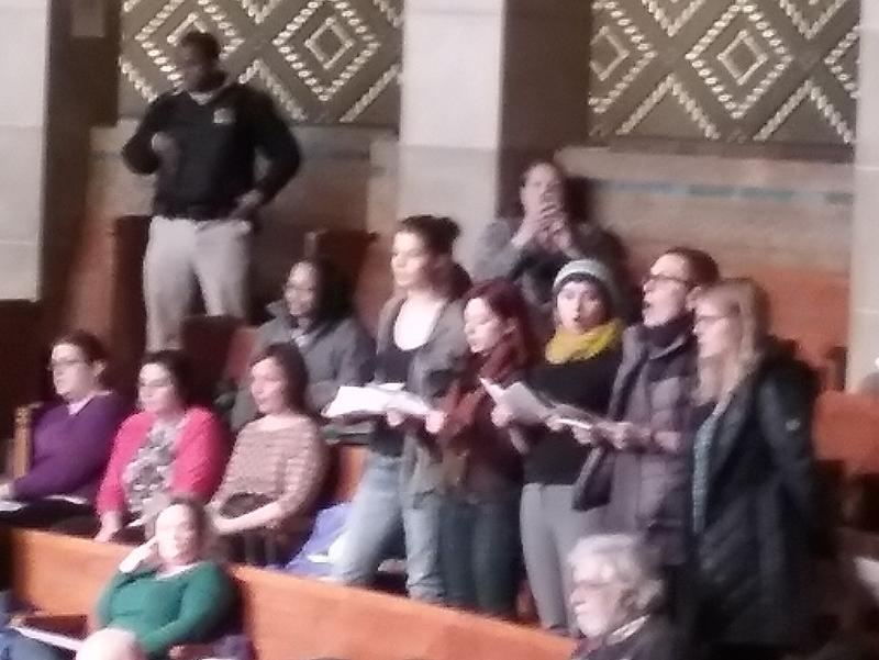 Protestors chant in Common Council chamber.