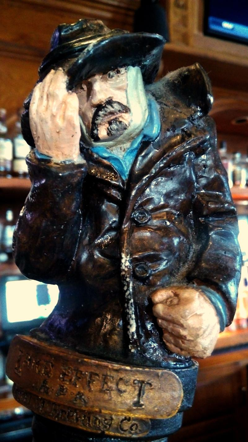 by ANGELICA A. MORRISON / Lake Effect man on the handle of a beer tap at the Pearl Street Grill and Brewery in Buffalo New York.