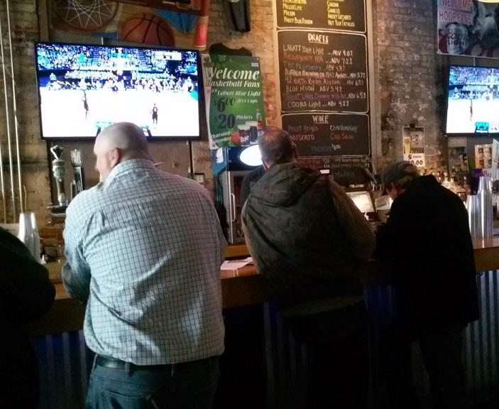 Fans also gathered in local bars to watch NCAA Men's Basketball Tournament action. These fans were watching Notre Dame vs. Princeton inside Buffalo Iron Works on Illinois Street.