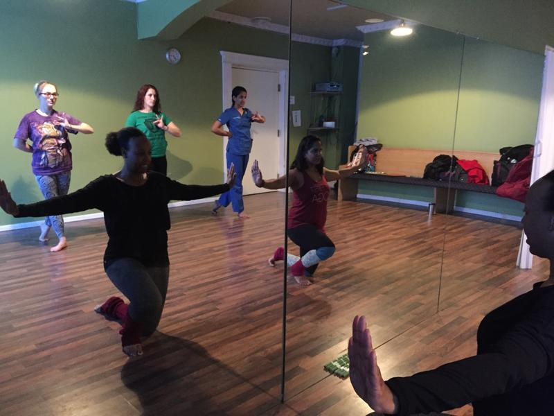 Gaitrie Devi, in the red shirt, teaches Bollywood dance at her Kenmore Avenue studio