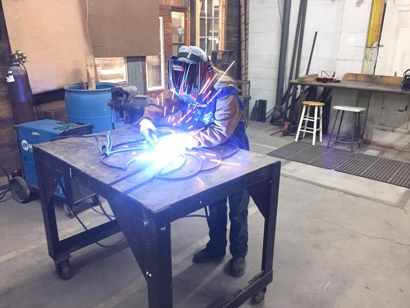 Sarah Fonzi arc-welding a decorative railing