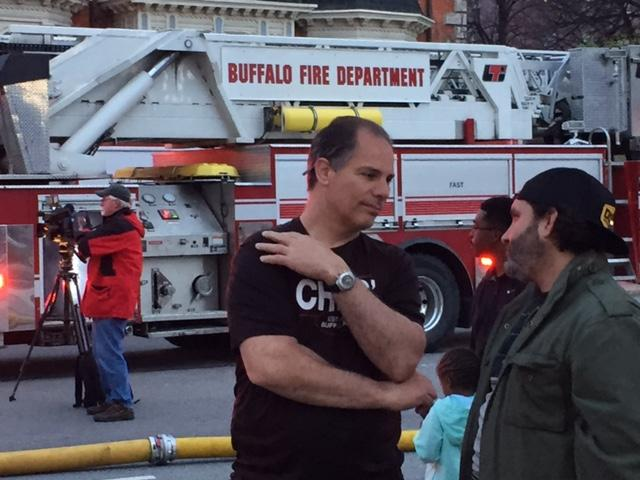 Restaurant owner Chris Vendetti gets fire update from resident Nathan Peracciny about the fire.the fire.