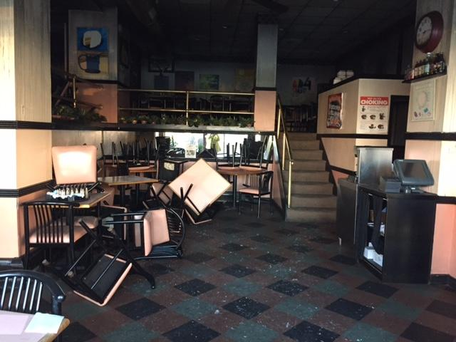 Damage inside Chris' New York Sandwich Shop.
