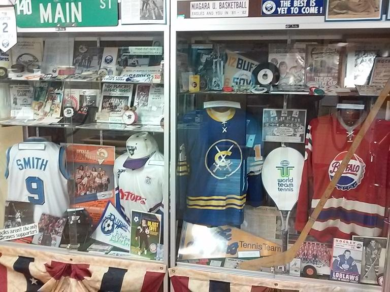 Various jerseys, programs and other mementos from some of the teams that once played in Buffalo. The blue hockey jersey in the right side was from the former Cincinnati Swords, a previous minor-league affiliate of the Buffalo Sabres.
