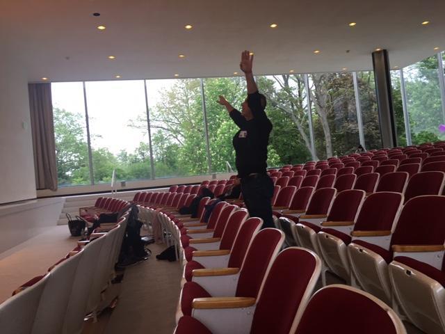 Jon Lehrer instructs his dance team.