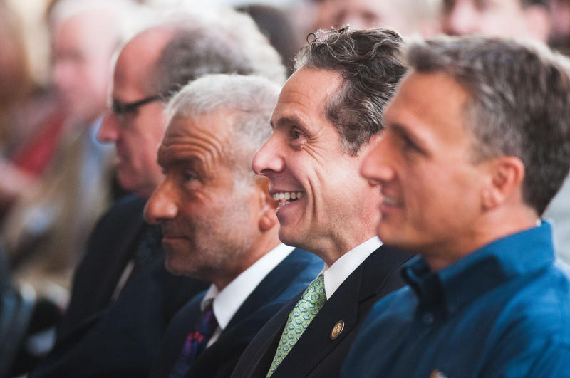 Former SUNY Polytechnic Institute CEO Dr. Alain Kaloyeros, Gov. Andrew Cuomo and SolarCity CEO Lyndon Rive during the announcement of the SolarCity GigaFactory facility at the RiverBend site in Buffalo, Sept. 23, 2014.