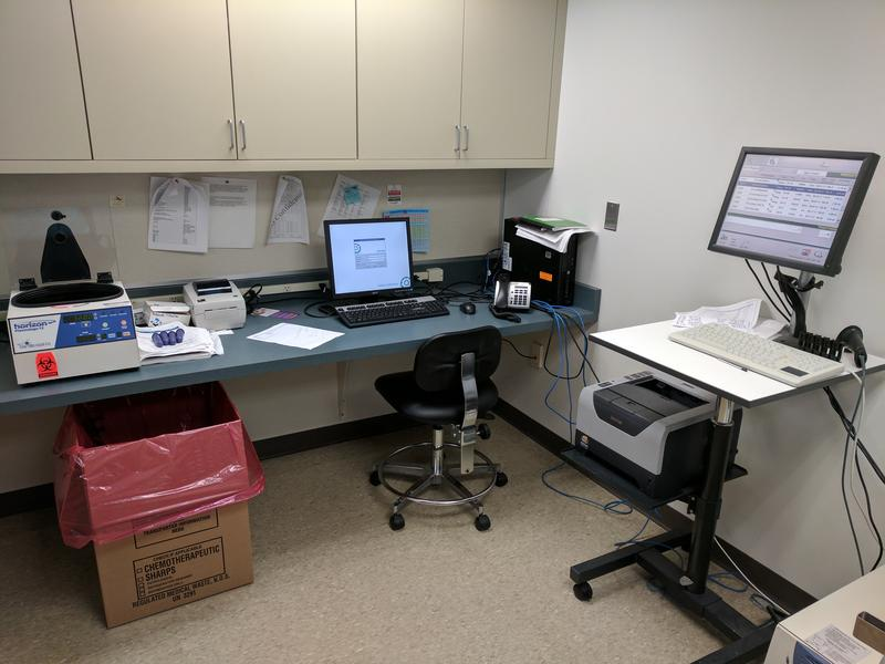 Centrifuge and computer equipment in the lab at the Hemophilia Center of Western New York