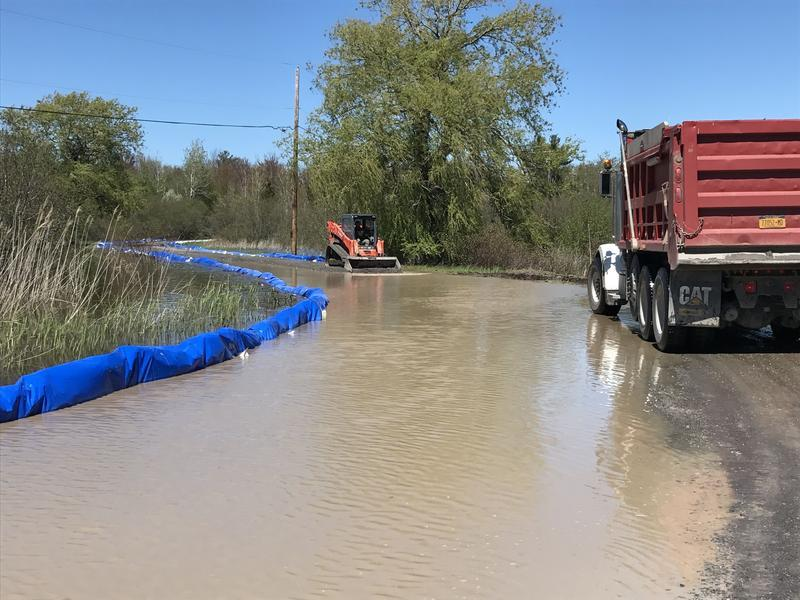 Goodnough says flooding could cost her business millions in lost income and repairs, like raising this swamped road.