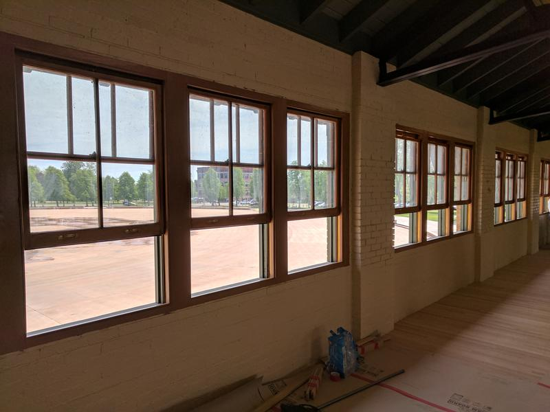 Individual windows currently fill the space where large picture windows once stood.