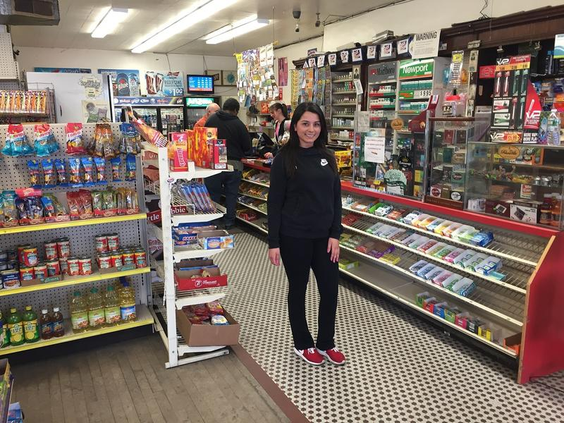 Brenda Mansour stands inside Mario's, which closed Saturday after decades of business. When her family bought the shop in 1986, they kept the layout - and atmosphere - the same as it was when operated by the family of founder Cesidio DiGregrio
