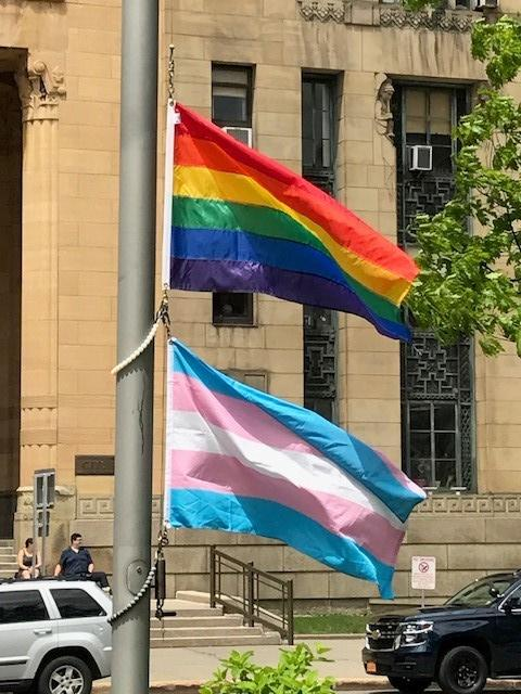 Both the LGBTQ (top) and trans pride flags were raised in Buffalo's Niagara Square.