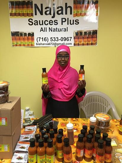 Bisharo Ali of Najah Sauces shows off the food items she'll be selling during the Queen City Pop-Up this summer.