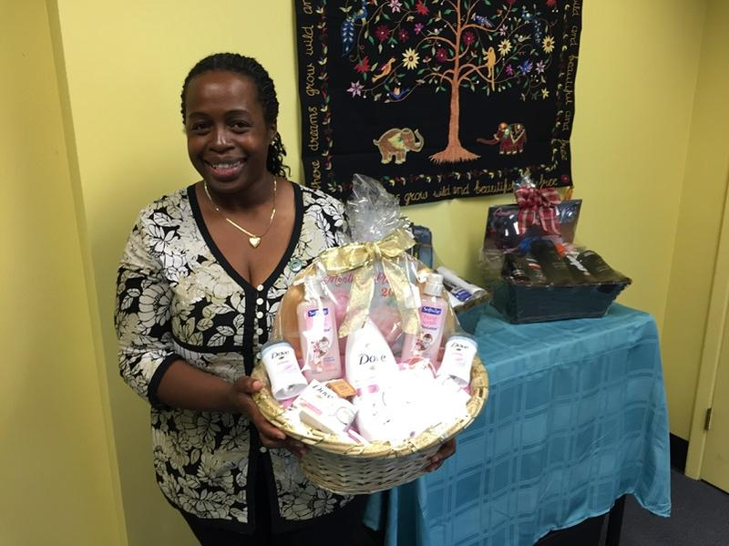 Regina Carter of Baskets By Ms. Regina shows a sample of the various custom gift baskets her business prepares for special occasions.