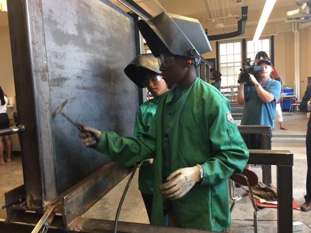 Burgard student working on welding skills.