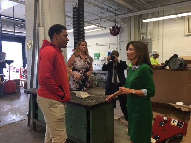 Burgard student meets Lt. Governor Hochul in automotive shop.