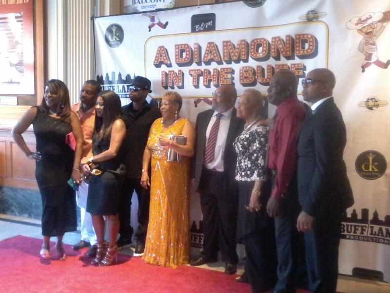 Lance Diamond's family pose for photos on the carpet.