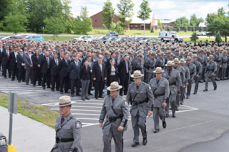 Troopers file into Magrath Sports Complex at Fort Drum.