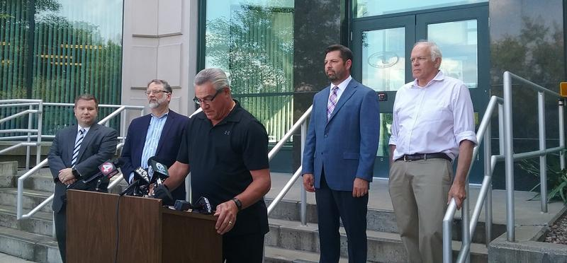 Niagara Falls Water Board Chairman Dan O'Callaghan (at podium) reads statement on steps of the board's headquarters.