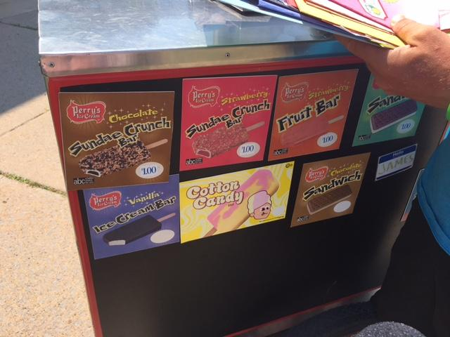 Different ice cream bar choices on the ice cart.