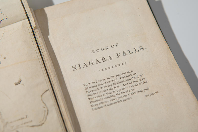 A closer view of the opening page of an early 1800s Niagara Falls tour book.