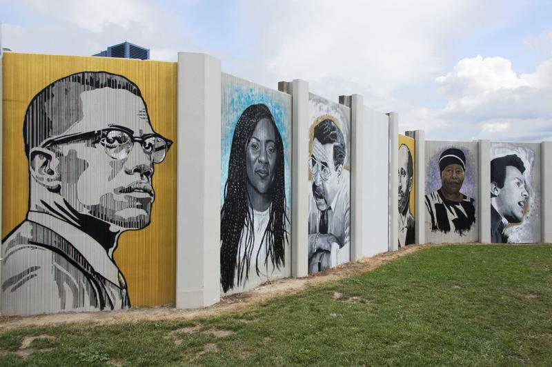 (left to right) Malcolm X, Alicia Garza, George K. Arthur, W. E. B. DuBois, Eva Doyle and Huey P. Newton are among the faces on the Freedom Wall.