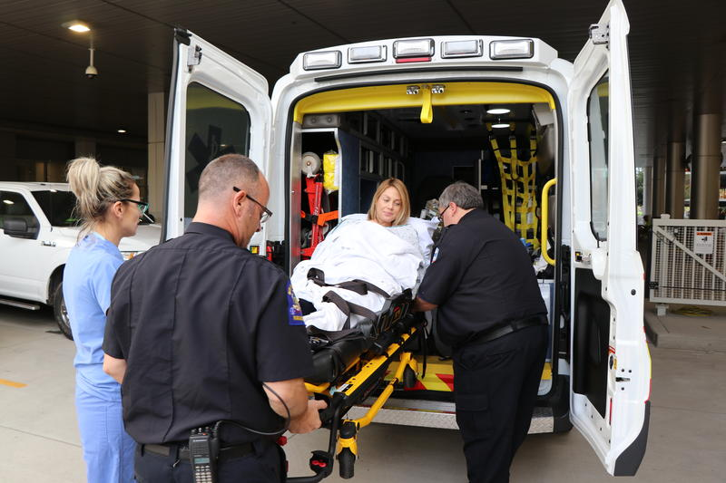 Erin Sassone is transported out of an ambulance, headed for the Oishei Children's Hospital emeregency department.