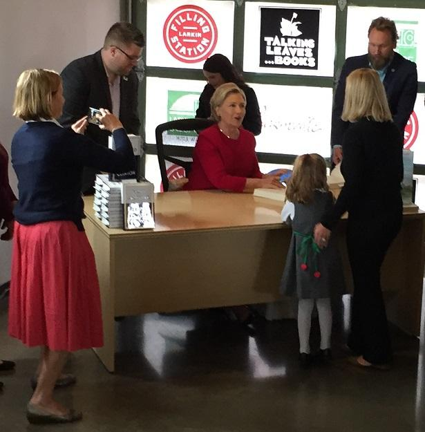 HIllary Clinton greets a supporter, as well as a future voter, at her book signing in Buffalo on Thursday.