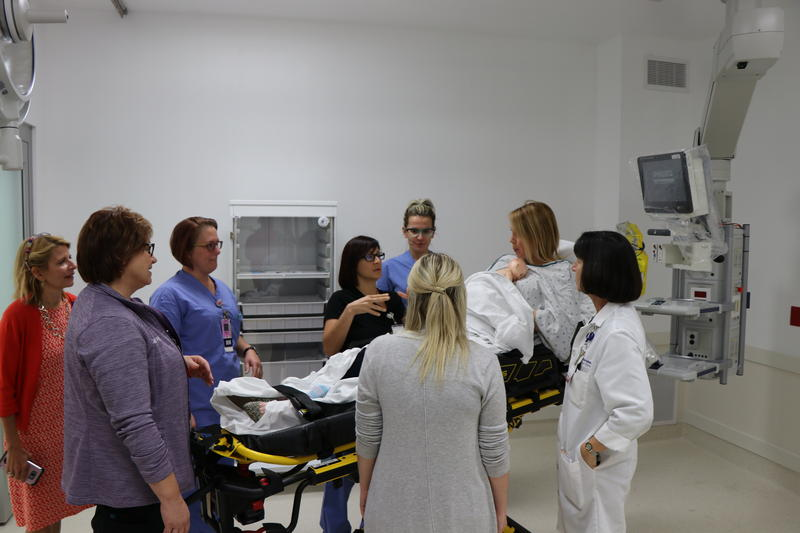 A team of hospital staff greets Sassone in the trauma room at the Oishei Children's Hospital.