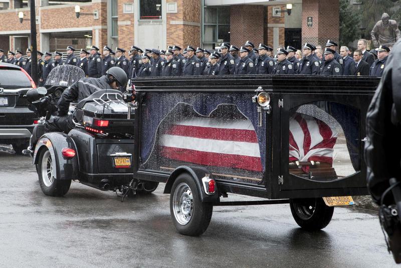 Lehner's casket was transported in a Harley Davidson attachment