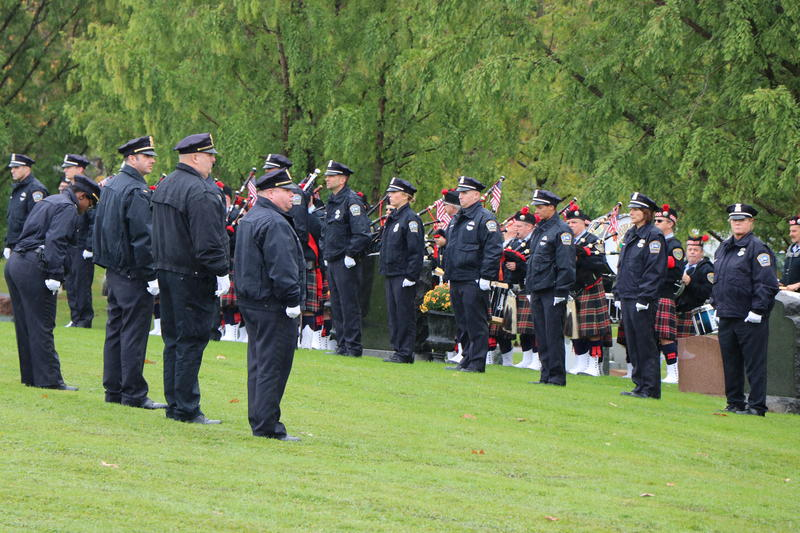 Members of the Buffalo Police Department line up in waiting for the passing of Craig Lehner's casket