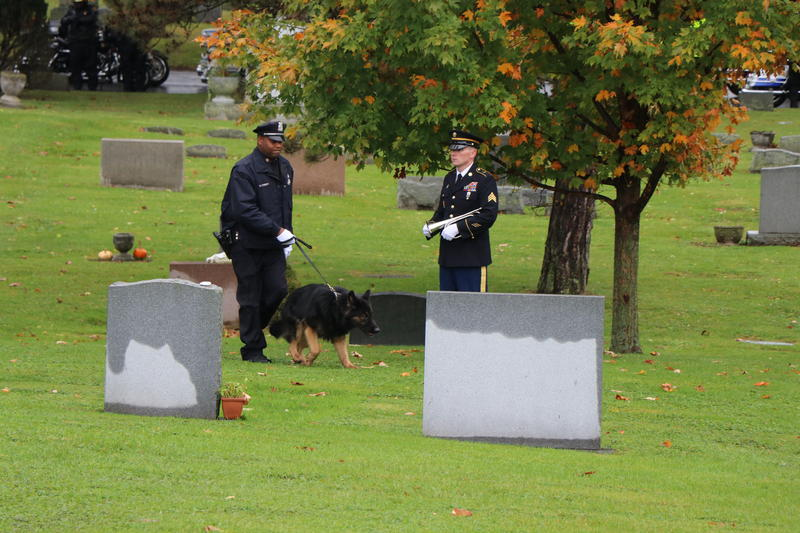 An Army bugler and members of the Buffalo Police Department's K-9 Unit prepare for the arrival of Craig Lehner's funeral procession