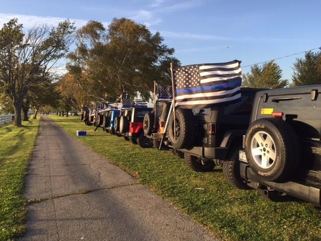 Members of the Jeep Wrangler Club of Western New York gathered for a vigil in honor of Buffalo Police Officer Craig Lehner