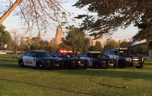 Vehicles from the Buffalo Police Department join the Members of the Jeep Wrangler Club of Western New York in honoring Officer Craig Lehner.