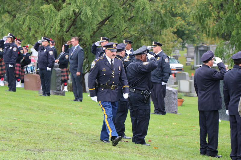 The head of the Buffalo Police Department's Honor Guard marches by as Craig Lehner's fellow officers render a last salute