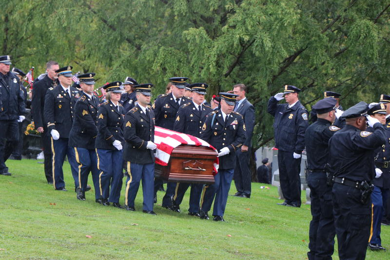 Army pallbearers carry the casket of Craig Lehner to its final resting place in Forest Lawn Cemetery