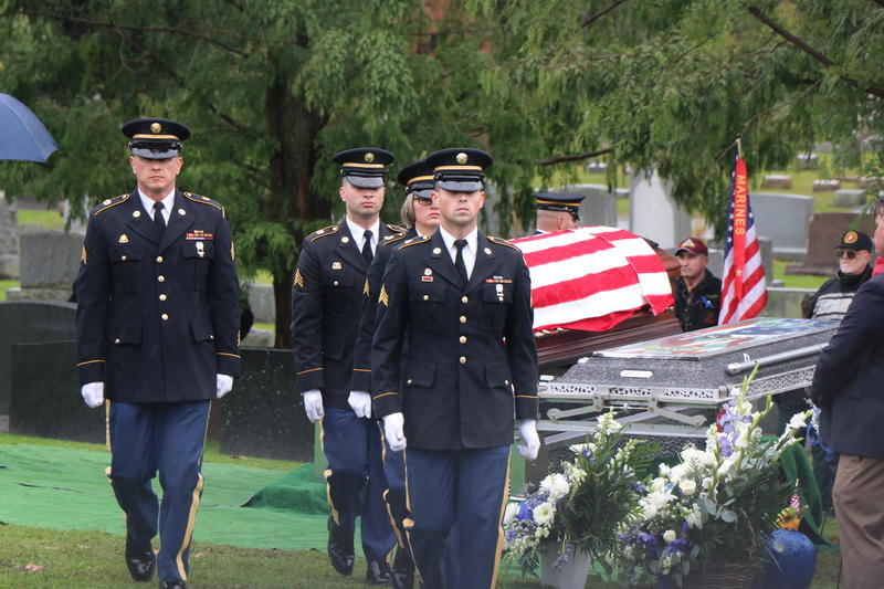 Members of an Army Honor Guard depart the grave of Craig Lehner