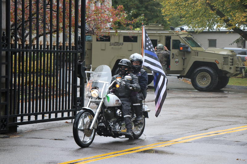 Motorcycles were among the many vehicles in the procession that took Craig Lehner to his resting place. This one was among the last to leave his funeral.