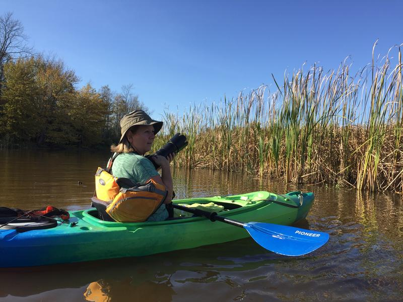 Karen Lee Lewis taking photographs while kayaking on Oak Orchard