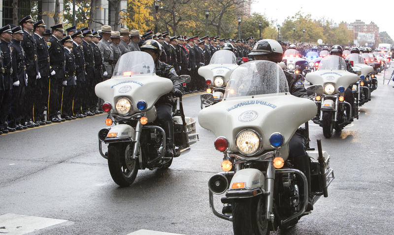 An escort brought Lehner's casket from a Hamburg funeral home to downtown Buffalo