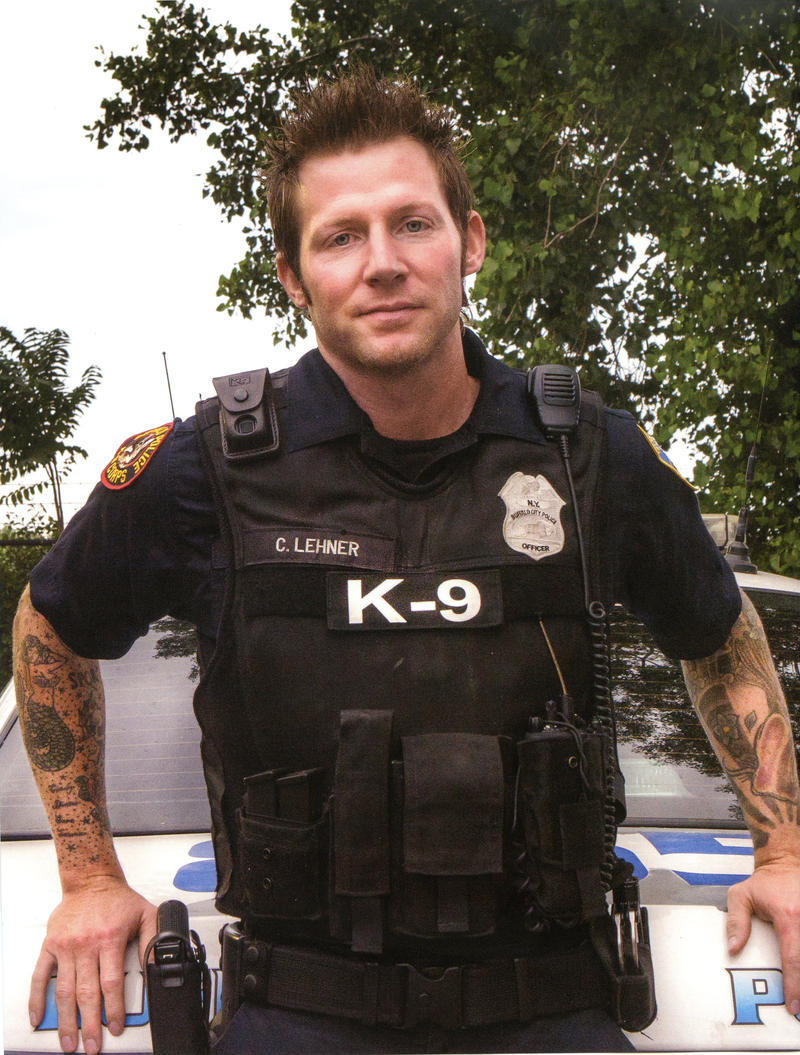A portrait of the tattooed officer, a member of the Buffalo Police K-9 unit