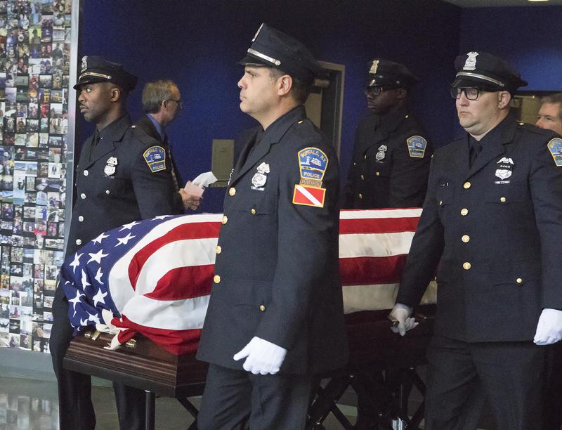 Lehner's flag-drapped casket exiting the arena