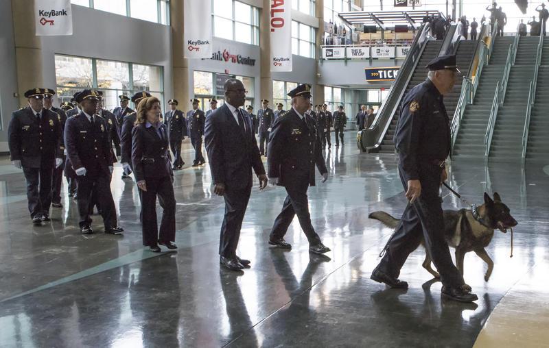 Buffalo Mayor Byron Brown, Lt. Kathy Hochul, and K-9 Shield entering the arena floor