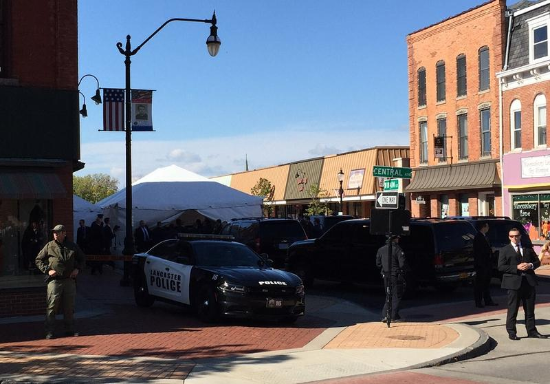 Vice President Mike Pence's vehicle disappeared under a tent but he briefly waved to bystanders before participating in a roundtable discussion in the Village of Lancaster Tuesday.